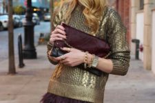 05 a gold cable knit sweater and a maroon feather skirt plus a matching clutch to sparkle