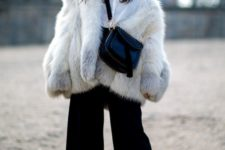 05 a white shirt, black culottes, a faux fur coat and snake print boots for a trendy feel