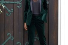 05 an emerald velvet pantsuit with black lapels, a black top with lace and black T-strap heels for a party