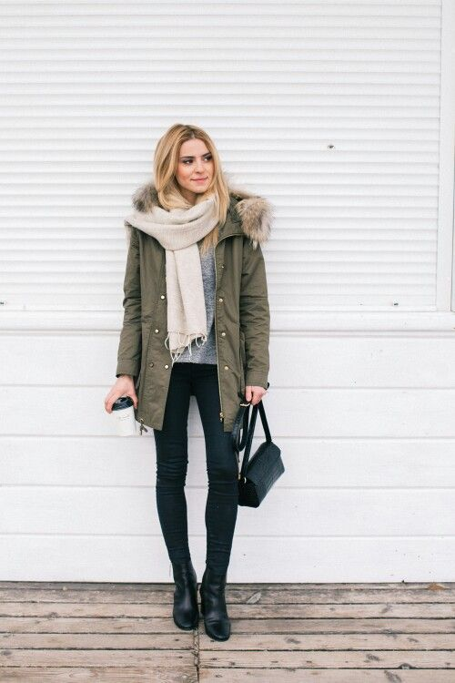 black skinnies, a grey sweater, a neutral scarf, black boots and an olive green parka with faux fur
