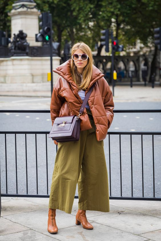 mustard culottes, a rust puffed coat and a purple bag for a bright and cheerful winter look