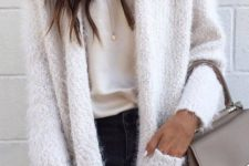 06 a black skinnies, a neutral top with lace, a fluffy creamy cardigan and a taupe bag