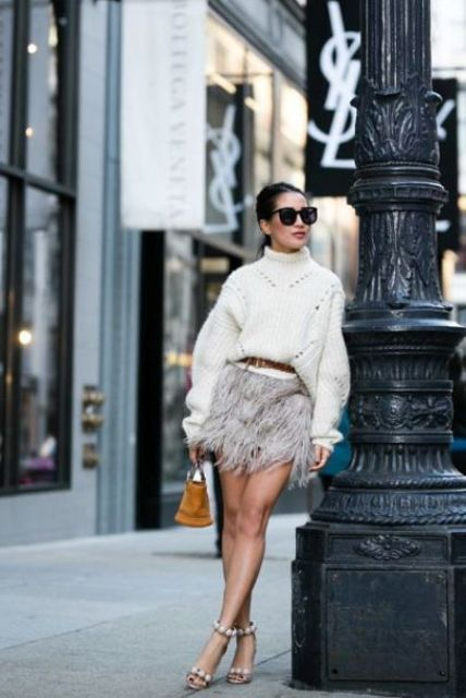 a creamy oversized sweater, a grey feather mini, beaded shoes and a small bag for a holiday party