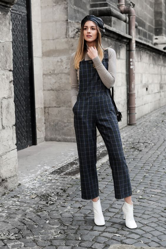 a grey sweater, a plaid overall, white booties and a black leather beret for a retro feel in your look