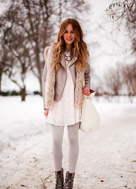 a white lace dress and white tights, a grey leather jacket, a furry vest, grey boots and a white bag