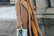 06 a yellow hoodie, cropped jeans, bold blue sneakers and a camel faux fur coat