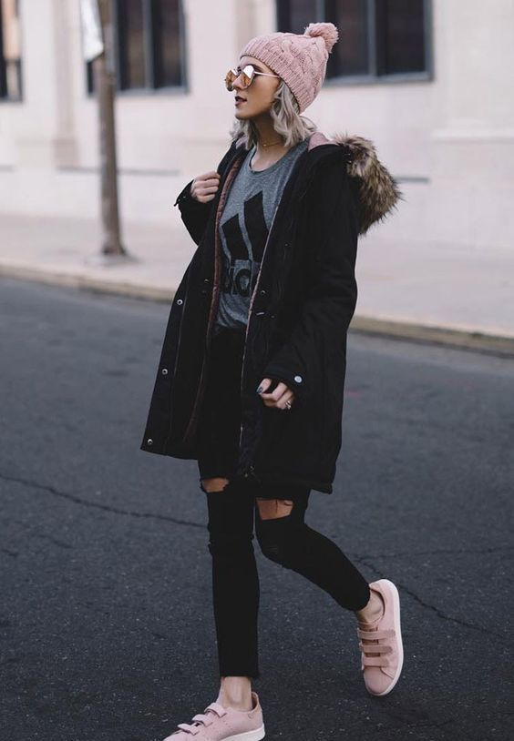 black skinnies, a grey t-shirt, pink flats and a beanie and a black parka