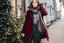 06 striped culottes, black boots, a grey top, a scarf, a beanie and a burgundy coat for a festive look