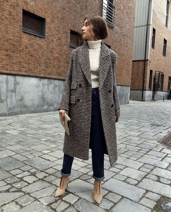 a chic look with straight jeans, neutral booties, a neutral turtleneck, a tweed coat of midi length