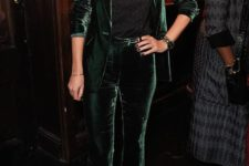 07 a dark green velvet pantsuit, a printed t-shirt, black flats for a cheery and trendy party look