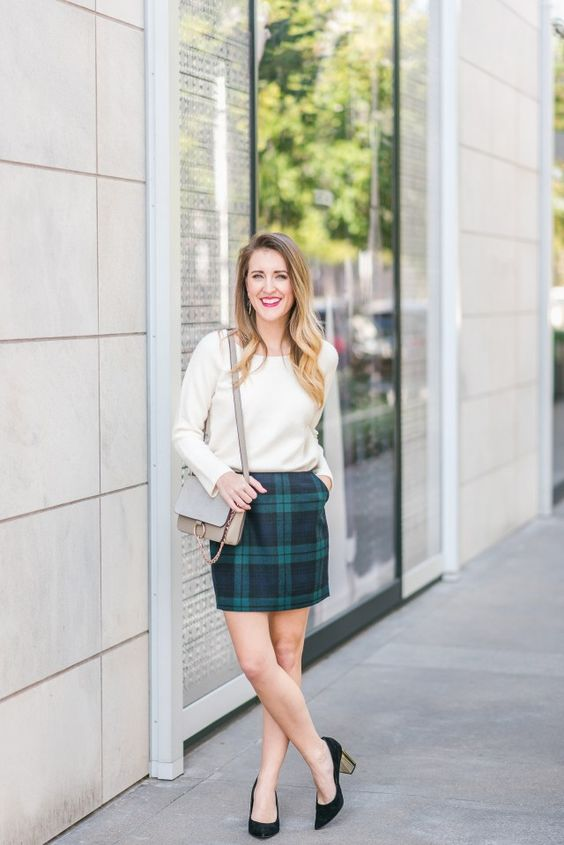a modest look with a neutral long sleeve top, a plaid mini and black shoes with metallic heels