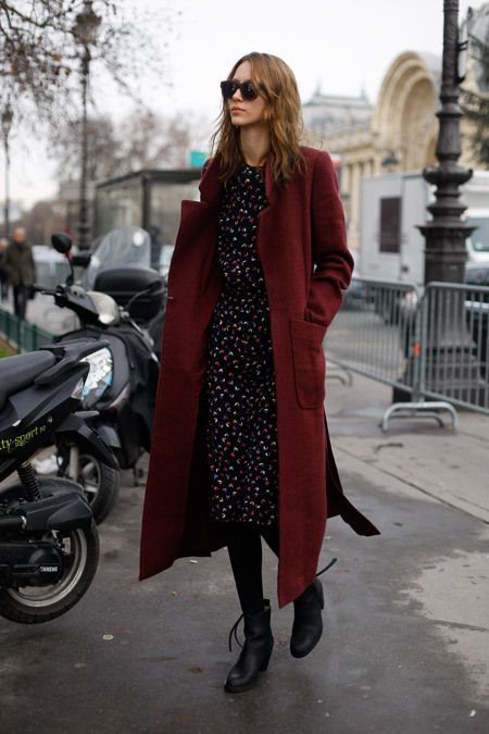 a moody floral dress, black tights, black boots, a burgundy midi coat for a rich-colored look