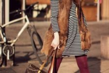 07 a striped short dress, burgundy tights, amber boots, a faux fur waistcoat, a burgundy scarf and a bag
