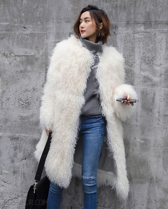 faux llama fur was on top but now it's not, take off such a coat and put it into the dresser