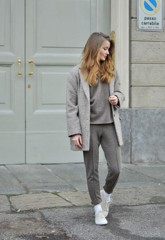 a beige wool tracksuit, neutral sneakers and a grey short coat for a very relaxed look