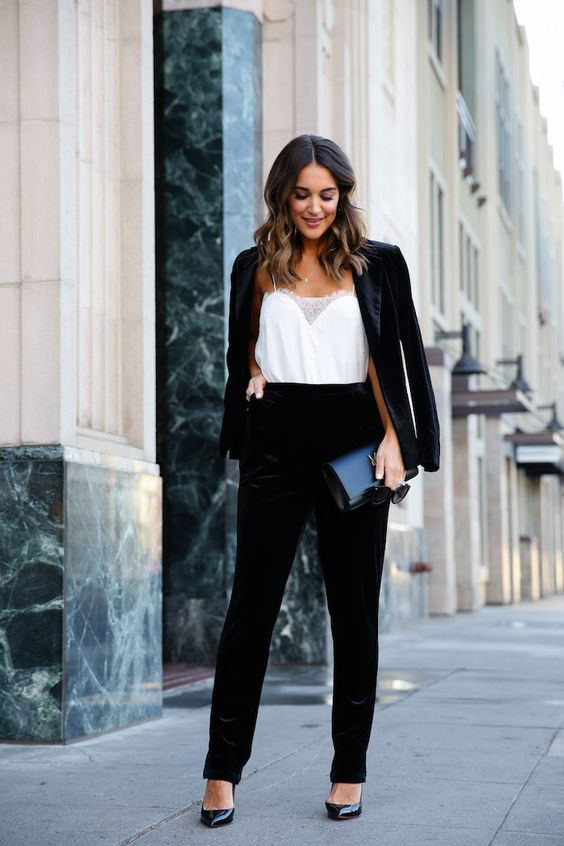 a black velvet pantsuit, a white lacey top and black heels are great to comprise a chic holiday outfit