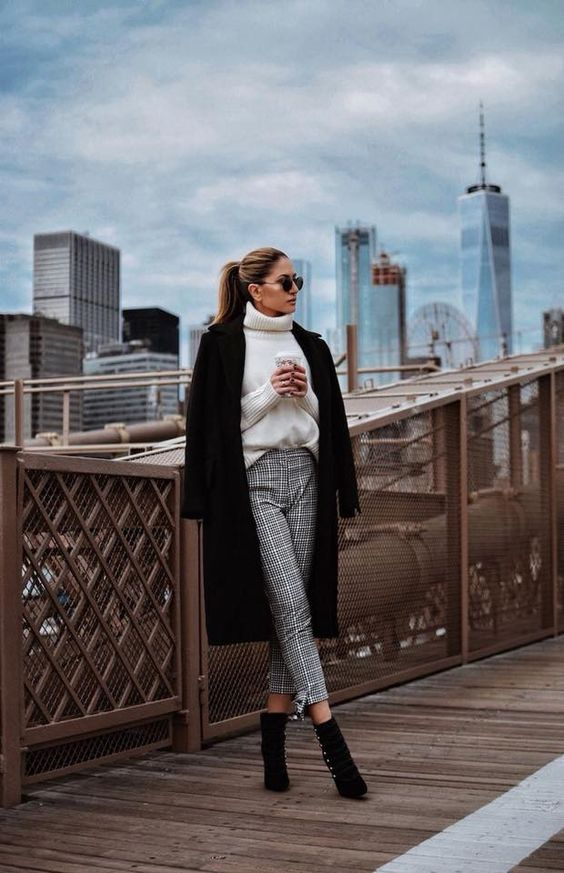 a chic winter look with plaid cropped pants, a white sweater, black booties and a midi winter coat