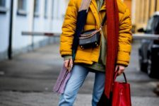 08 cropped jeans, chelsea boots, an olve green hoodie, a bold yellow puffed coat, a red bag