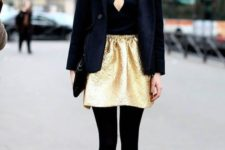 09 a black top with an embellished neckline, a gold mini, black tights and shoes plus a short coat