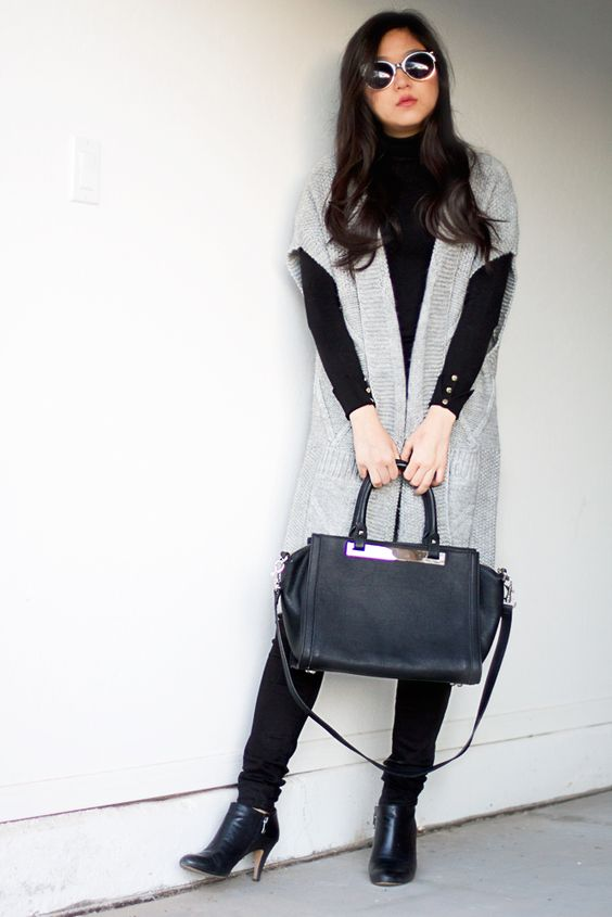 a black turtleneck, black pants and booties, a black bag and a long grey cardigan for comfort