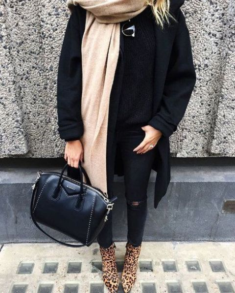 a black sweater, coat, ripped skinnies, a neutral scarf and leopard print boots
