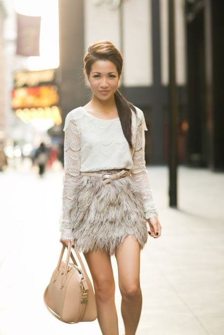a grey lace top, a grey feather mini, a beige belt and a beige bag for a more neutral look