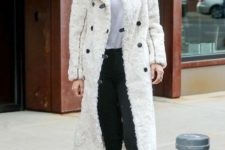 09 a white tee, black jeans, creamy combat boots and a matching faux fur coat by Gigi Hadid