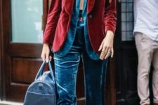10 a blue velvet pantsuit, a burgundy velvet blazer on top and a blue bag for a layered look