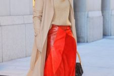 10 a camel coat and turtleneck, a red leather midi skirt, red boots and a brown bag