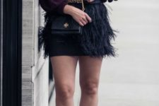 10 a plum sweater, a black infinity scarf, a black mini feather skirt, black shoes and a bag