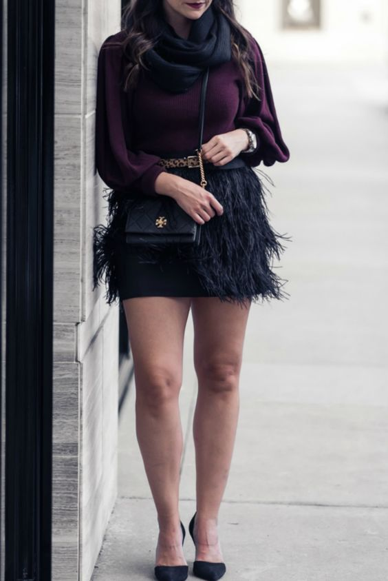 a plum sweater, a black infinity scarf, a black mini feather skirt, black shoes and a bag