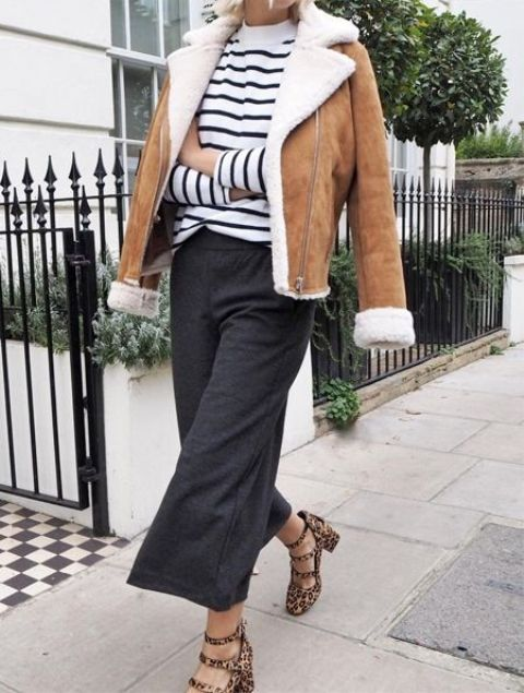 a striped top, grey culottes, animal print shoes and an amber shearling coat