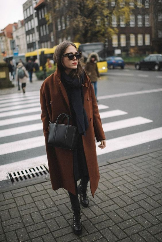 a total black look with a scarf, rock boots, a bag and a chocolate brown coat