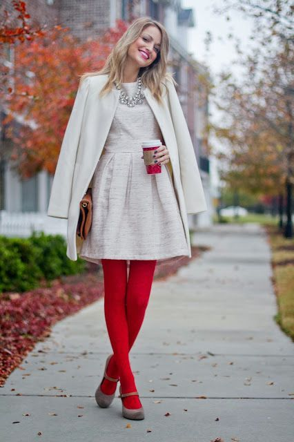 a white A-line dress, a creamy jacket, red tights, grey shoes and a statement necklace for a party