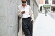 a white shirt, grey cropped pants, black flat shoes and a creamy cardigan for a minimalist look