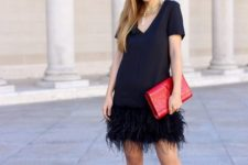 11 a black dress with a feather skirt, a red clutch and red spike shoes plus a statement necklace