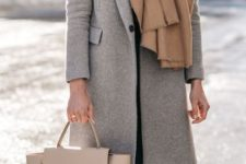 11 a comfy grey coat and a beige layered scarf for a comfortable and warm winter look