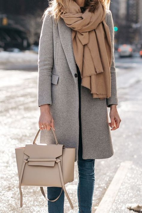 a comfy grey coat and a beige layered scarf for a comfortable and warm winter look