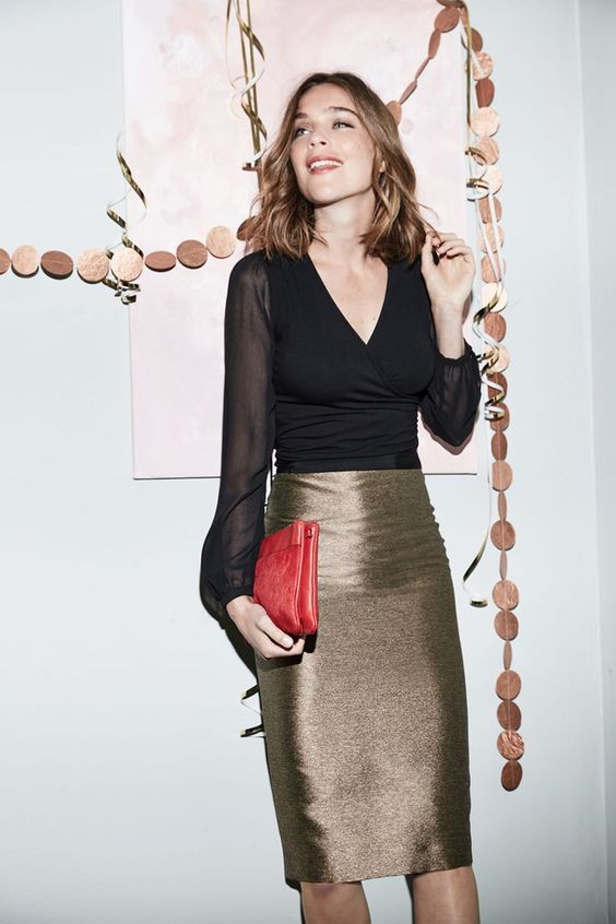 a metallic knee pencil skirt, a black blouse with sheer sleeves and a red clutch for a laconic yet festive look