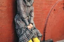 11 a plaid ruffle dress with a high low skirt, yellow tights, white sneakers