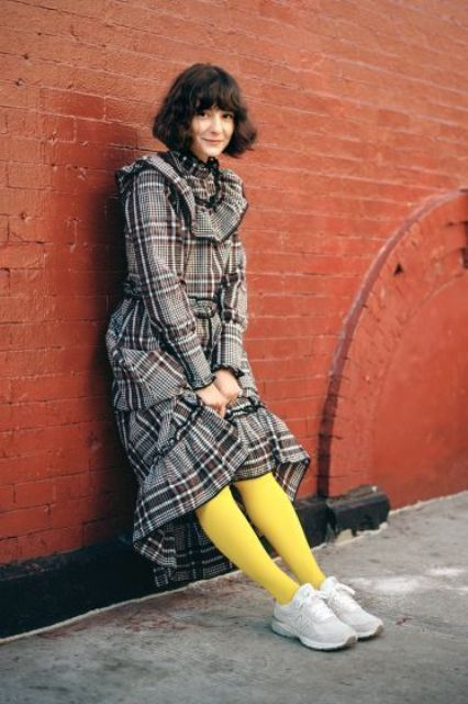 a plaid ruffle dress with a high low skirt, yellow tights, white sneakers