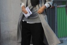 11 a white shirt, a grey sweater, black culottes, black flats, a grey coat and a black scarf for a minimalist look