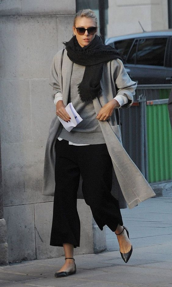 a white shirt, a grey sweater, black culottes, black flats, a grey coat and a black scarf for a minimalist look