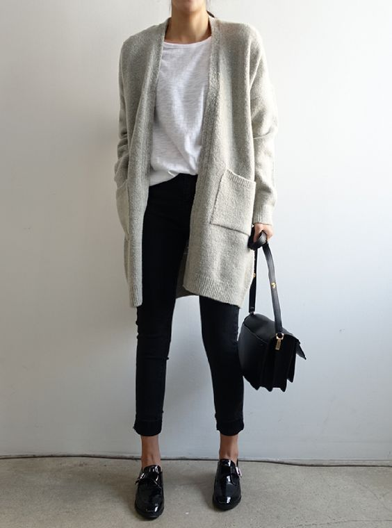 a white tee, black cropped pants, an off white long cardigan, black flat shoes and a black bag