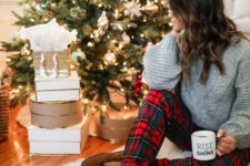 11 plaid pants, a grey sweater, moccasins for a stylish winter or Christmas look