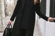 a black mini dress, a black coat, black printed tights, black boots, a black bag and a grey beanie