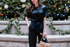 12 a black silk jumpsuit with wideleg pants, heels and a bow on the waist and a neutral bag