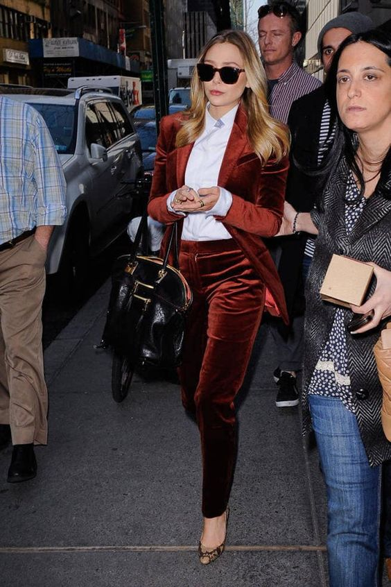 a burgundy velvet pantsuit, a white shirt, printed shoes for a statement look
