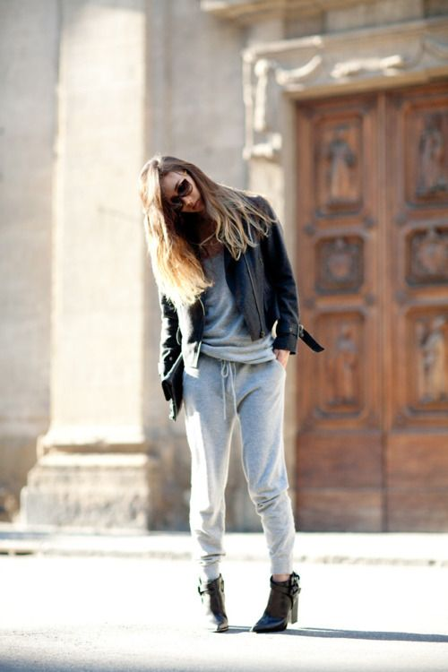a grey cashmere tracksuit, a black leather jacket, black booties are all you need for an effortless look