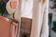 12 a white tee, brown leather pants, a neutral long cardigan, a rust bag for fall or winter